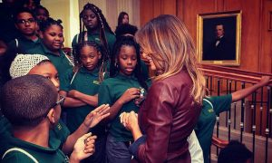 School girl bored during meeting Melania Trump