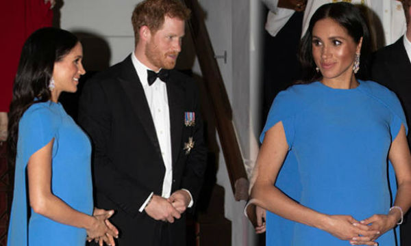 Meghan Markle flaunts her baby bump