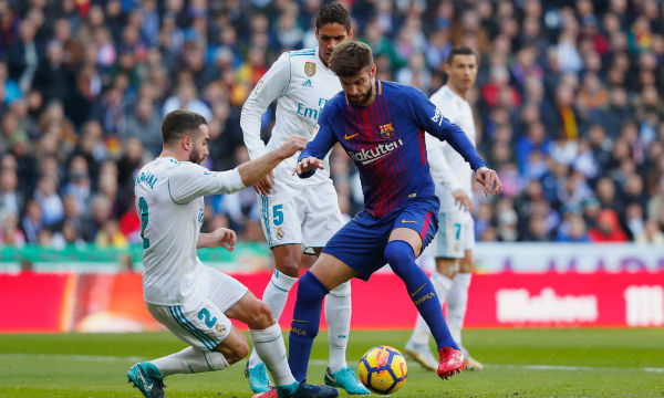 Barcelona star Gerard Pique blames referees for helping Real Madrid