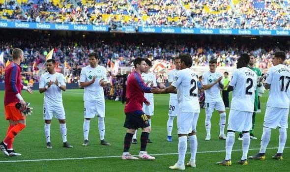 Barcelona 'celebrate' La Liga title in empty Camp Nou as fans booed Messi.
